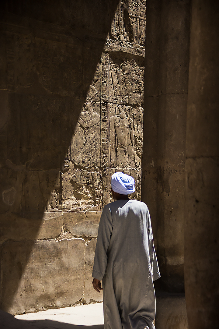 A man in the ruined hall of Luxor temple